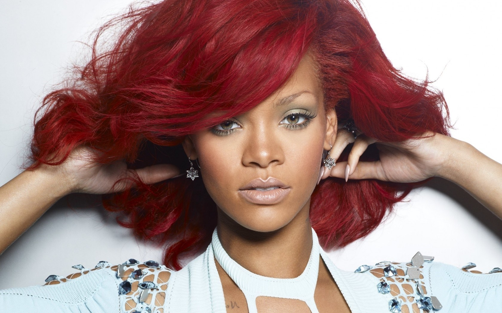 Rihanna strips off AGAIN as she goes topless for new