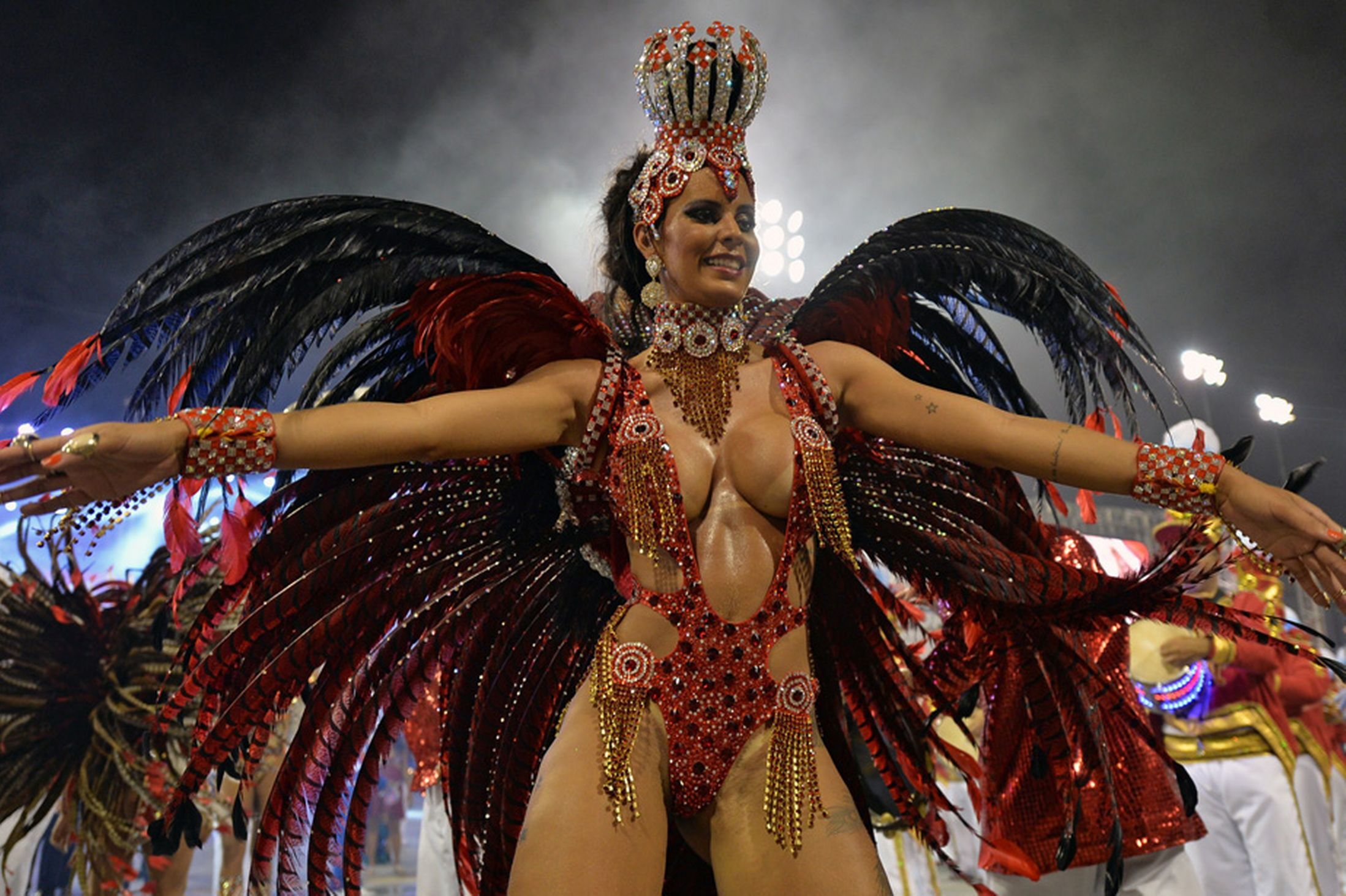 A reveler of the Perola Negra samba school performs during the second night of carnival parade at the Sambadrome in Sao Paulo, Brazil on March 1, 2014 (Photo Credit: Daily Mirror)