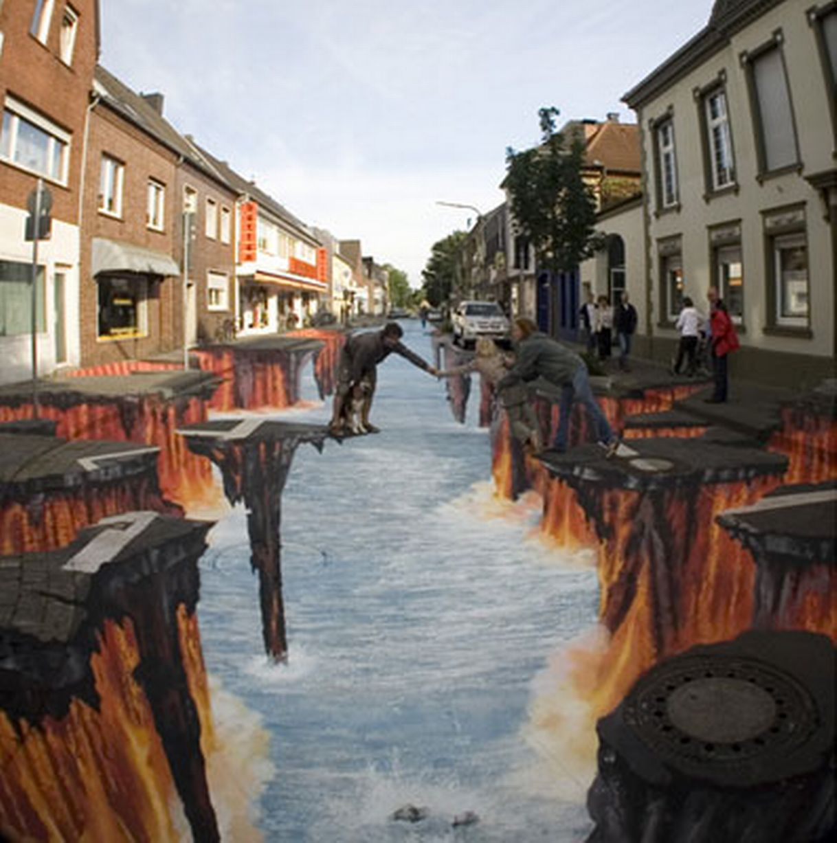 Road to hell: Artist Edgar Mueller transformed an ordinary street in his native Germany into an apocalyptic scene that could have come straight out of a Hollywood movie. Mueller created the 3D art work for a street painting contest.