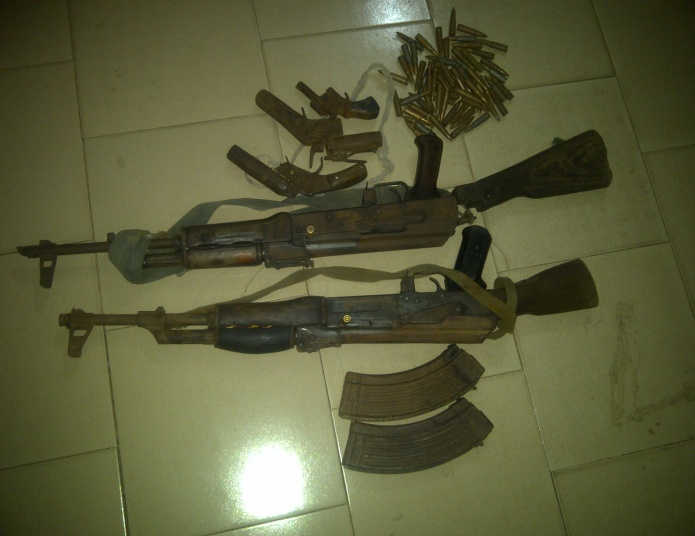 Some of the arms recovered by Nigerian Troops on Wednesday, May 7, 2014 (Photo credit: Defence headquarters)