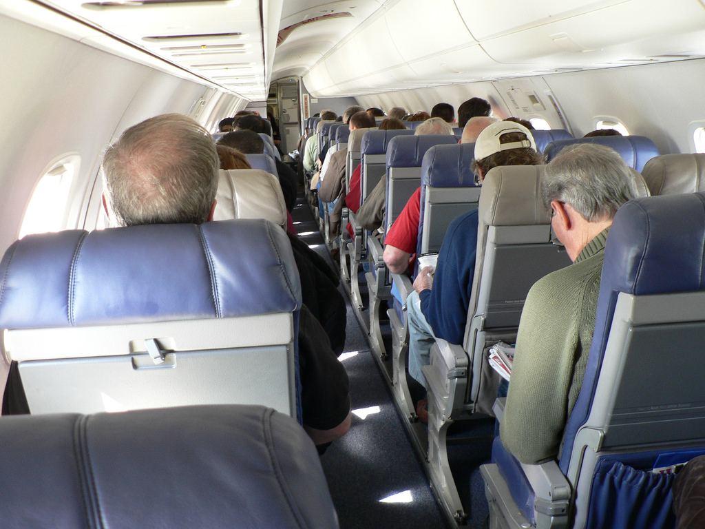 Passenger Strips NAKED Lnside Plane And Asks Flight