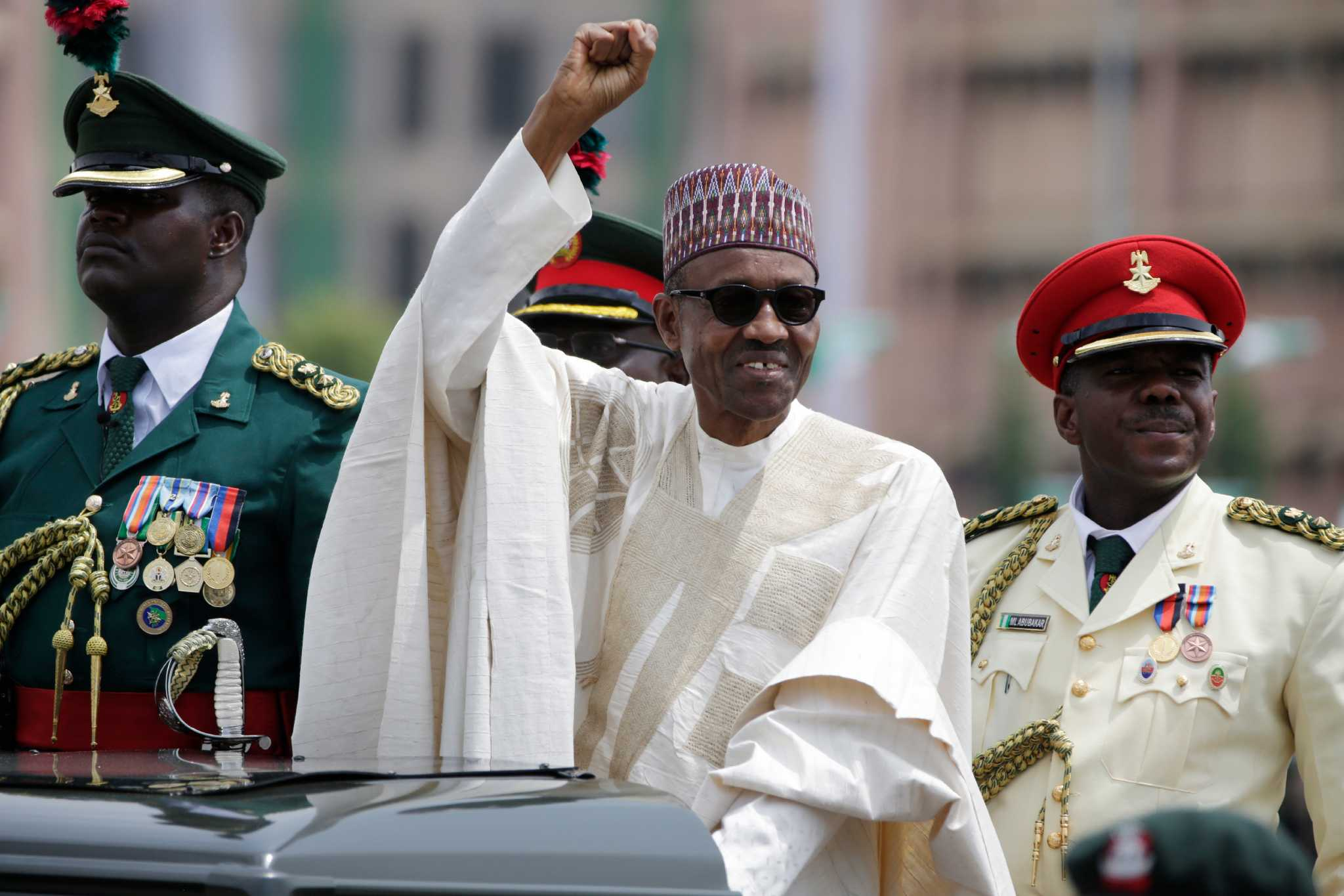 President Muhammadu Buhari, salutes his supporters during his Inauguration in Abuja, Nigeria, Friday, May 29, 2015. | AP/Sunday Alamba