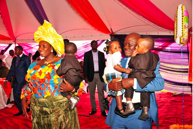 Mr. Gordon Obua is pictured at a thanksgiving service with his wife, Dr. (Mrs) Merit Obua holding their triplets recently. (Photo Provided by Merit Obua)