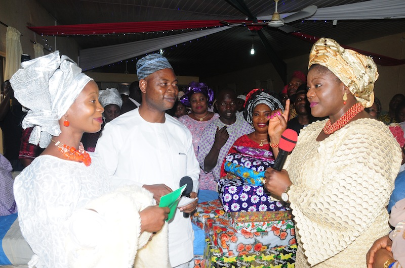 Ondo First Lady, Mrs Olukemi Mimiko, donating gift items to Mother of the First Baby of the Year, Omoboyede Adewon while the State Health Commissioner, Dr Dayo Adeyanju, looks on. | Ondo TV