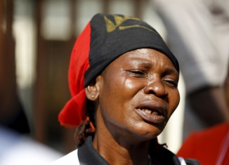 rising sun A Biafra supporter cries during a rally in support of Nnamdi Kanu