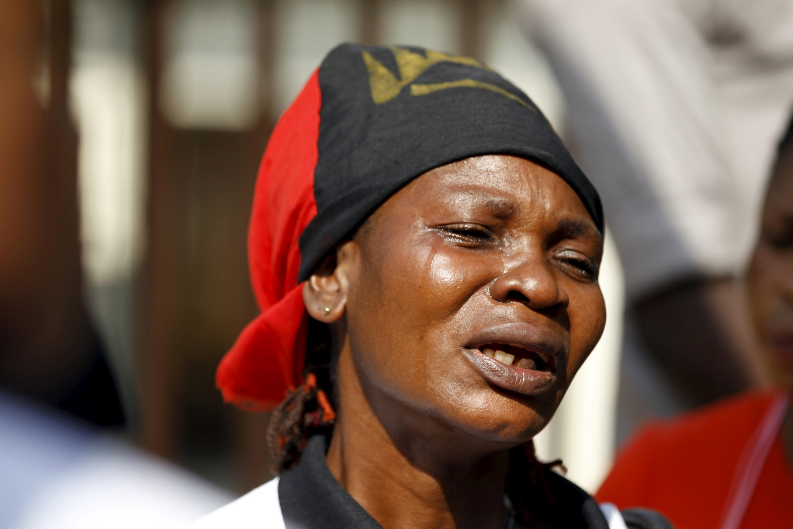 A Biafra supporter cries during a rally in support of Nnamdi Kanu in Abuja, December 1, 2015. Dutch lawyers have filed a case against Nigerian President Muhammadu Buhari for alleged crimes against humanity against pro-Biafran activists. | Afolabi Sotunde/Reuters