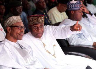 Rotimi Amaechi (right) with President Muhammadu Buhari at a function