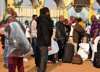File: Nigerian Nigerians deported speaking pictured at an airport germany