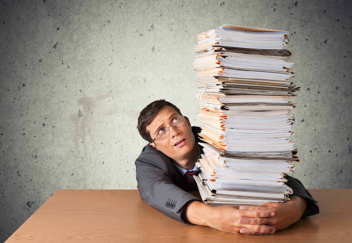 Stack. files bureaucracy Office worker holding paperwork stack